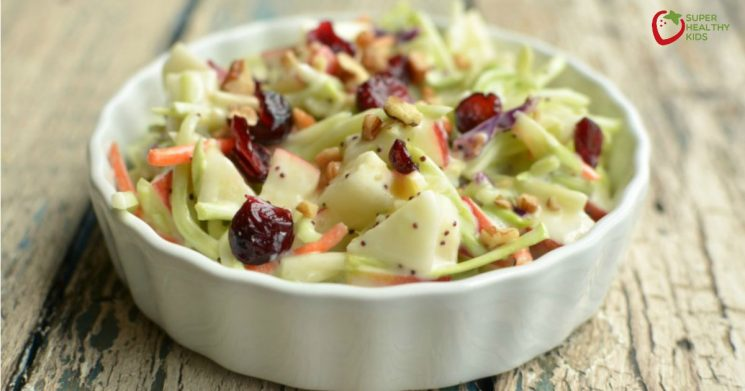 broccoli apple salad with a poppyseed dressing in a small serving dish