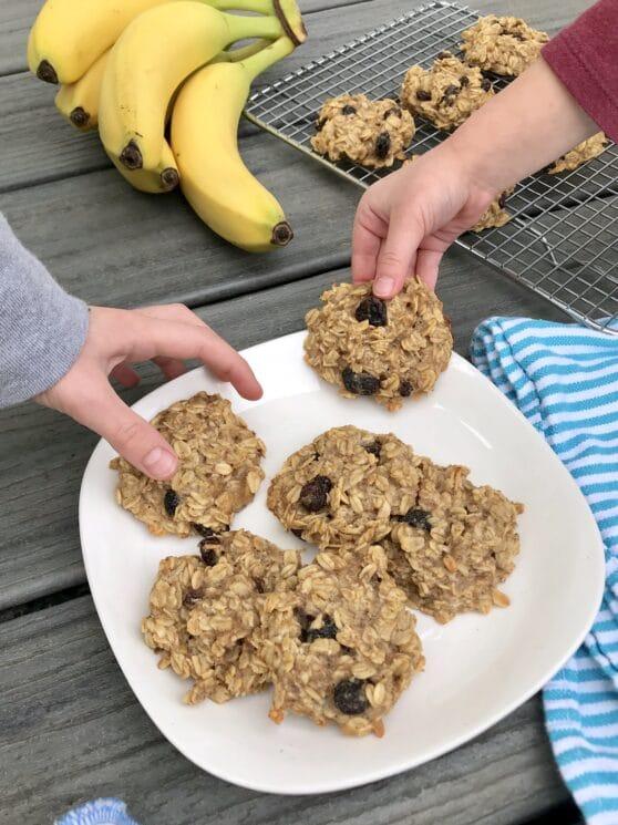 kids picking up fresh homemade sugar free cookies