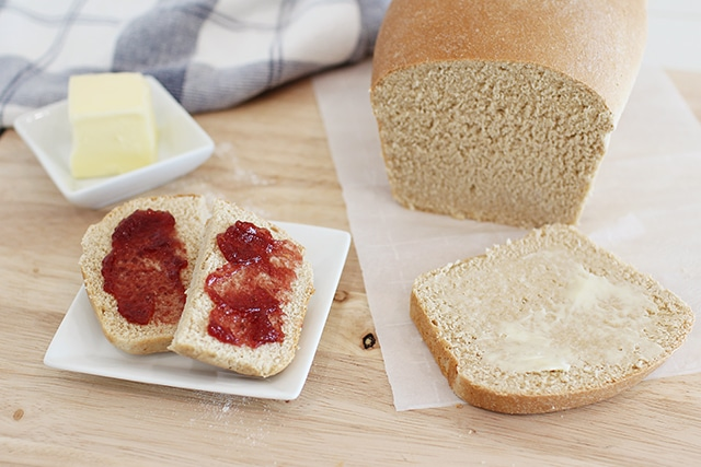 White whole wheat bread with butter and jam