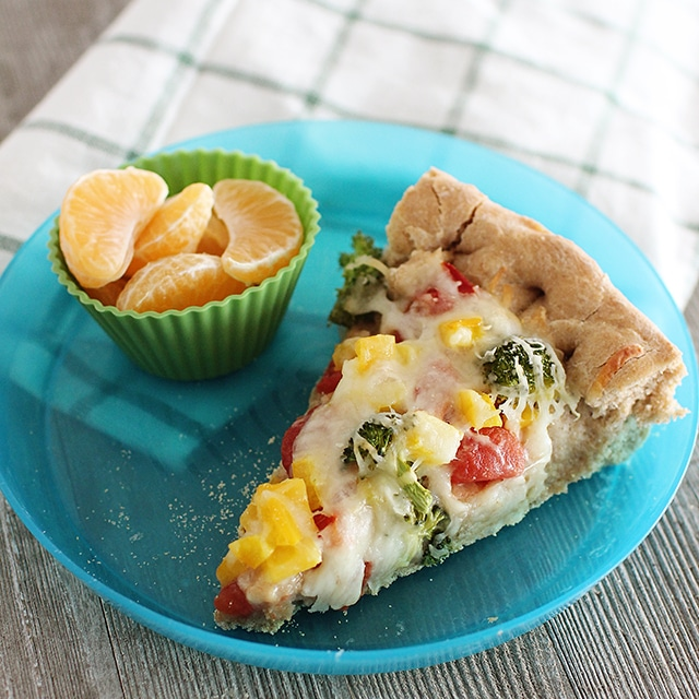 veggie pizza on kids plate with oranges