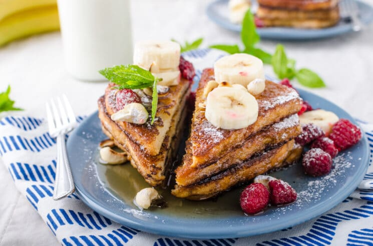 Flax French Toast Triangles with fruit healthy breakfast ideas for kids with raspberries and bananas