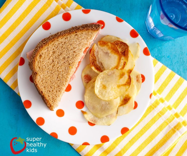 Oven Baked Potato Chips Recipe. Send homemade potato chips to school! Once you get the hang of it, they're a snap!