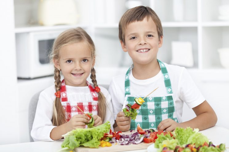 Happy kids preparing a meal in the kitchen