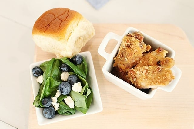 salad with blueberries chicken and a roll