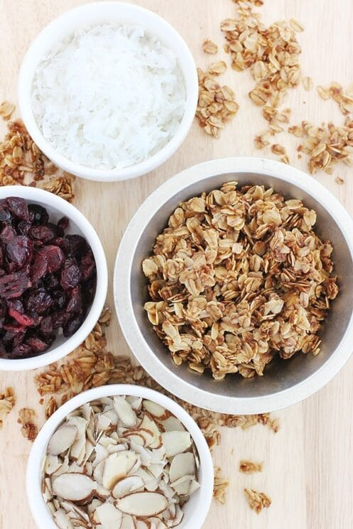 bowls of coconut, cranberries, almonds, and homemade granola