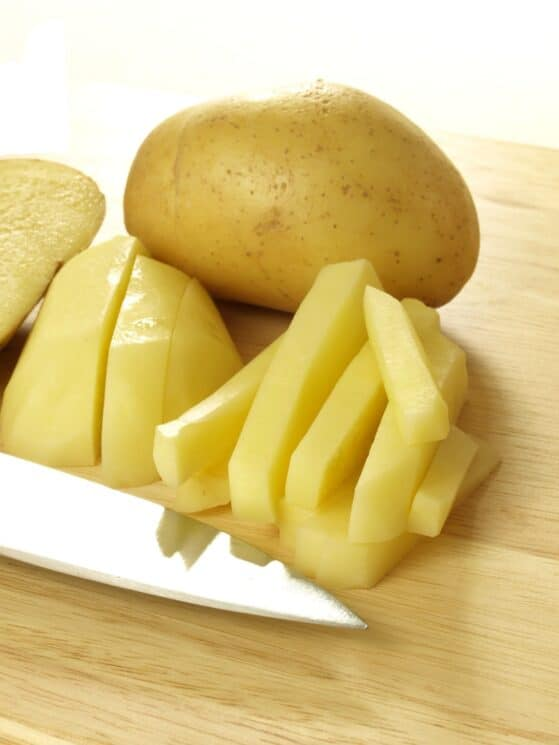 slicing potatoes for french fry recipe