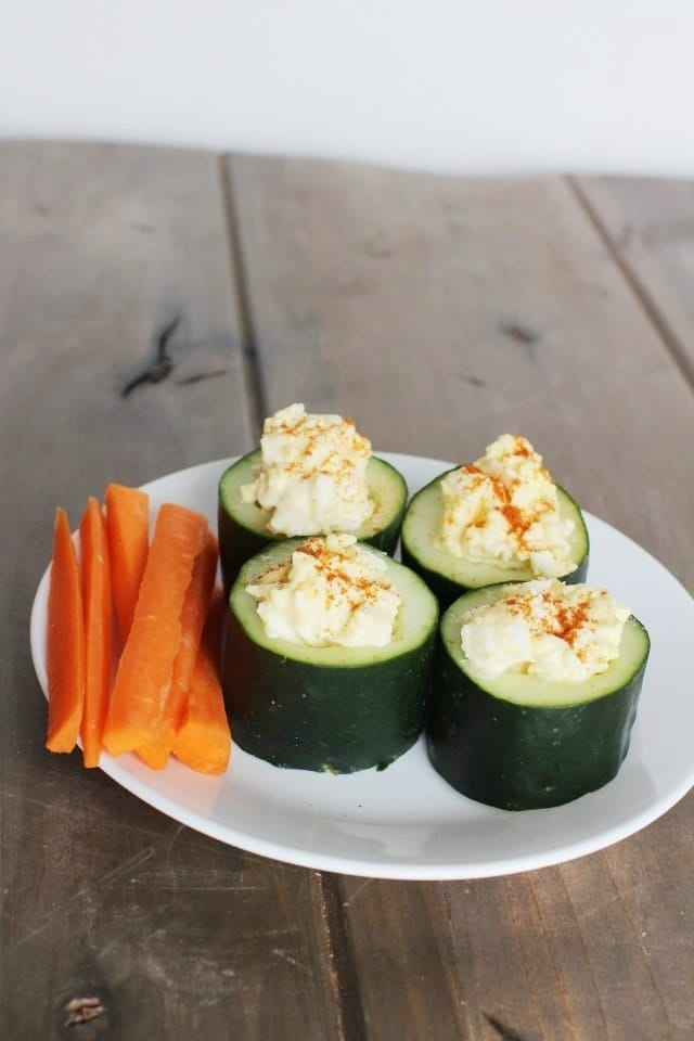 Loaded Cucumber Cups filled with egg salad. Side of carrot sticks.