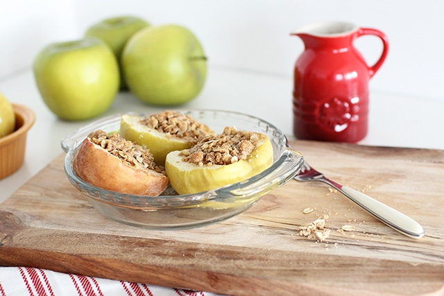 baked apples in a dish on a cutting board