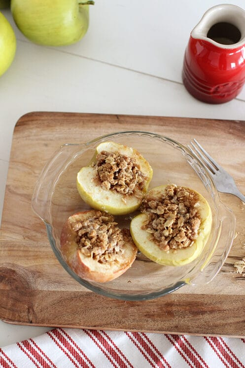 baked apples in a dish with oat topping