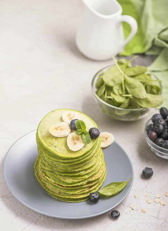Green pancakes with spinach, healthy breakfast or snack, vegetarian food