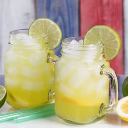 all natural hydration drink in a glass with lime slices