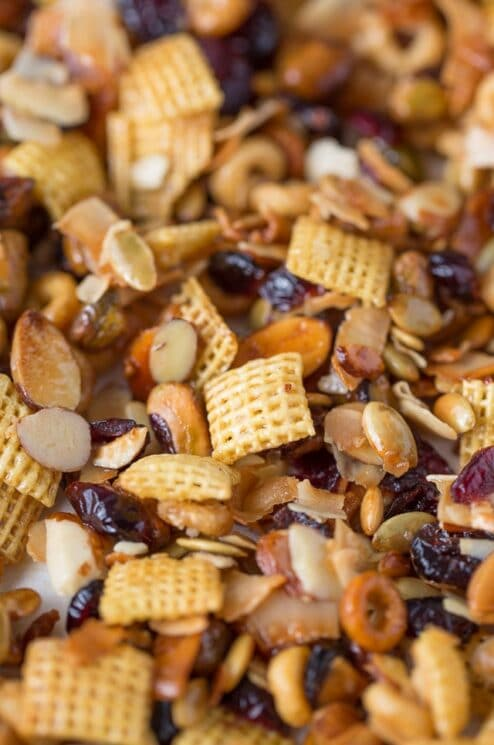 snack mix with cereal squares, dried cranberries and nuts