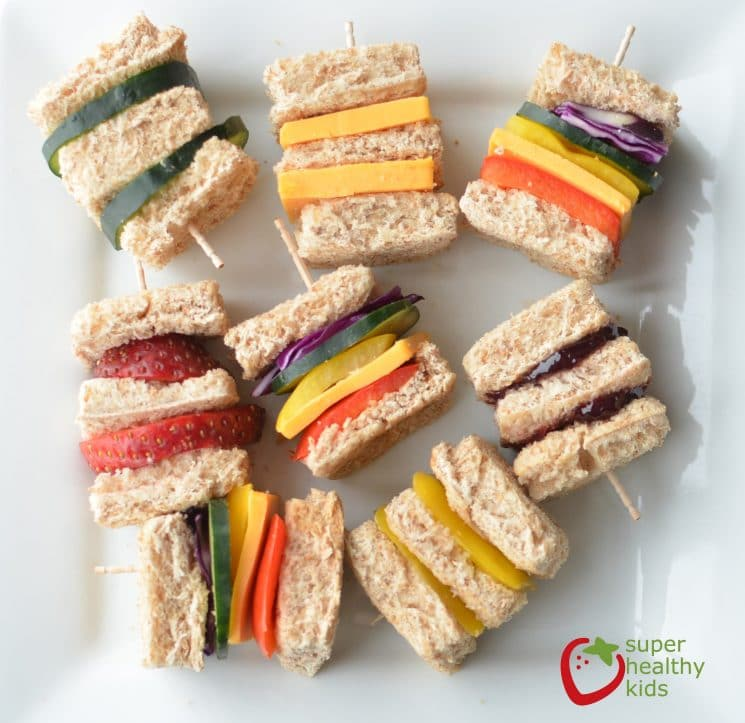 Lunch Box Idea: Mini Rainbow Sandwiches. Lunch box idea using a variety of fruits and veggies for mini sandwiches.