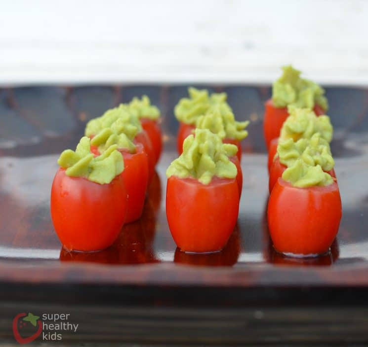 Tomato-Avocado Cup Snacks. Check out this simple snack! Bring them to a party, or just eat them all by yourself!