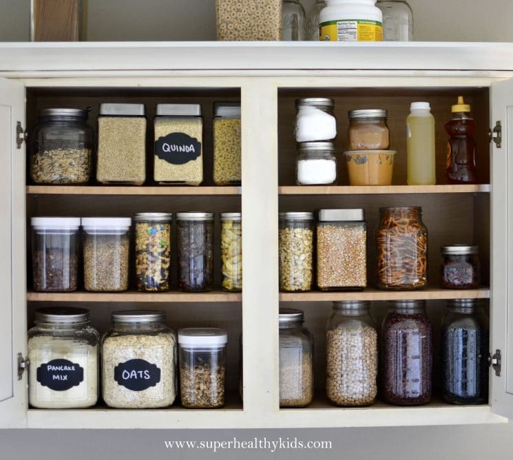 Kitchen Cabinet Makeover- Getting rid of the packaging! Where organization meets small kitchen!