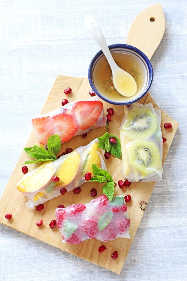 Fresh Fruit Spring Rolls. A delicious and tasty sweet twist on spring rolls, filled with fresh fruit and served with a honey lime dip. www.superhealthykids.com
