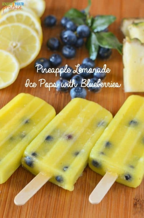 Pineapple Lemonade Ice Pops with Blueberries. Super refreshing with an amazing flavor! www.superhealthykids.com