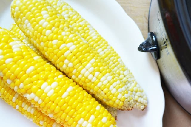 Slow Cooker Corn on the Cob. Game changer - sweet perfectly cooked corn with no effort at all! www.superhealthykids.com