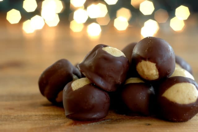 Allergen Friendly Holiday Buckeyes. Creamy on the inside, sweet chocolate shell - perfect holiday treat! www.superhealthykids.com