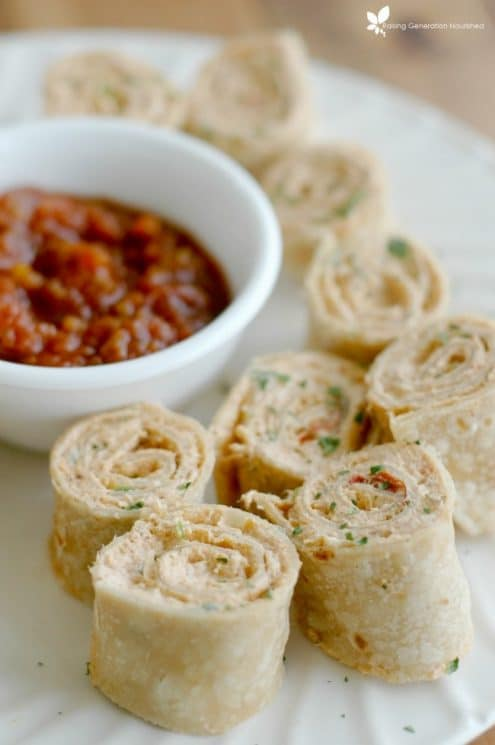 Mexican Pinwheels on a platter with salsa for dipping