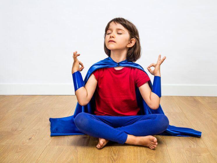 child in a yoga pose