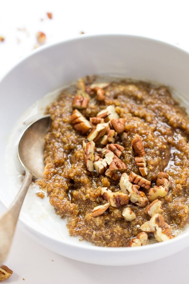 Gingerbread Breakfast Quinoa -- made with two types of quinoa, sweetened with maple sugar and topped with crunchy pecans!
