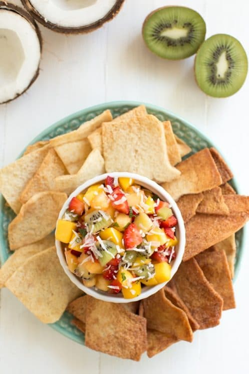 Easy Tropical Fruit Salsa made with fresh mango, pineapple, kiwi, strawberries and unsweetened coconut! www.superhealthykids.com