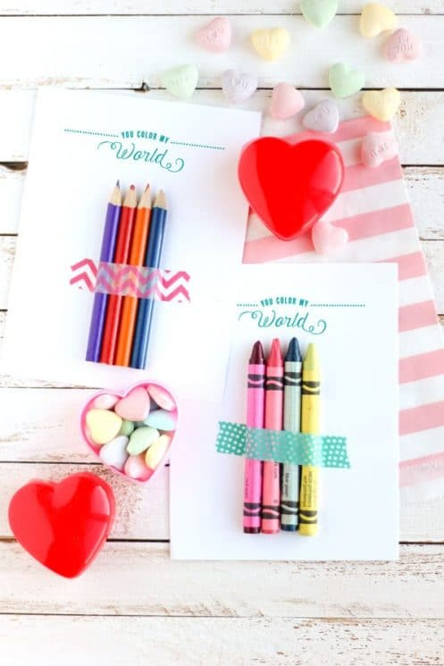 valentines with crayons taped on them