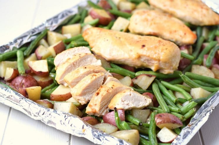 One Pan Honey Garlic Chicken and Vegetables - Chicken breasts, potatoes and green beans all cook together in under 30 minutes and in one pan. As simple and easy as a healthy dinner recipe gets! www.superhealthykids.com