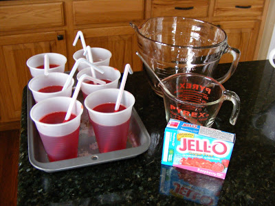 cups of jello with a straw to resemble a cup of juice