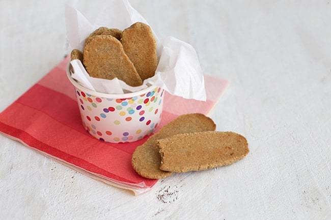 a container of homemade teething biscuits on a red napkin
