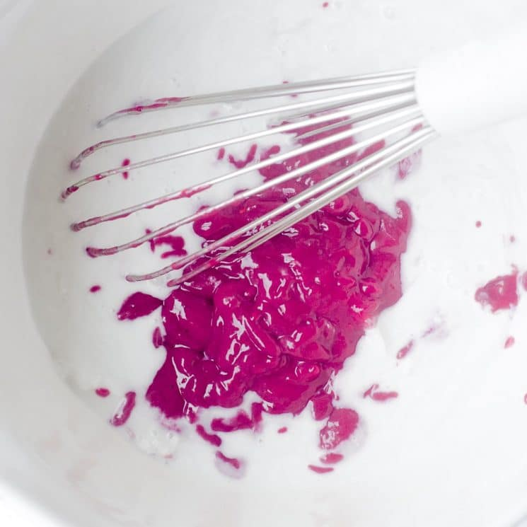 Making healthy Sugar Free Vegan Raspberry Ice Cream with fresh raspberry puree