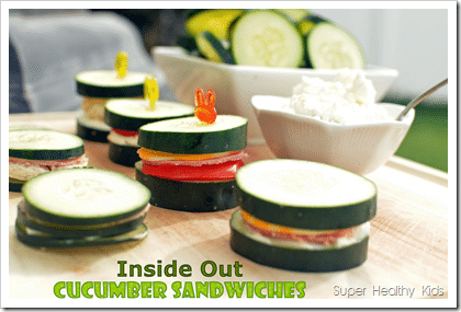 cucumber slices used as the bread for mini sandwiches with ham and cheese with decorative picks