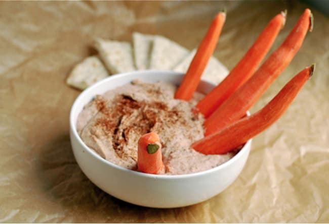 Hummus with carrot fingers