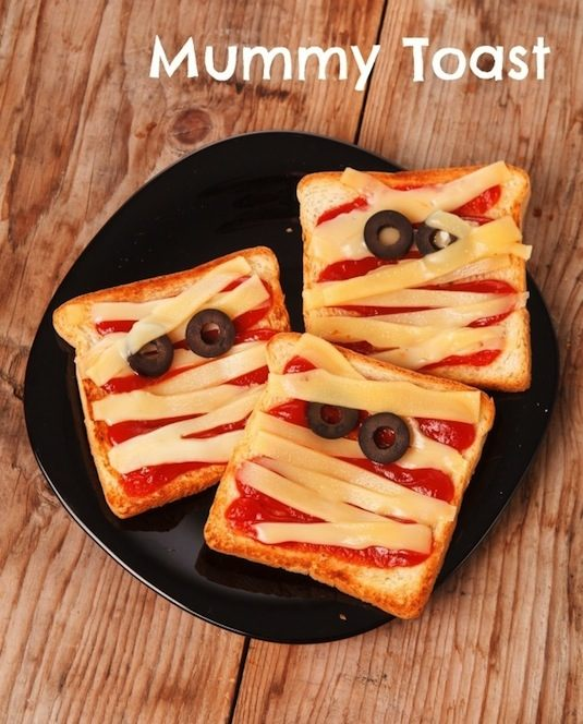 Mummy toast with strips of cheese