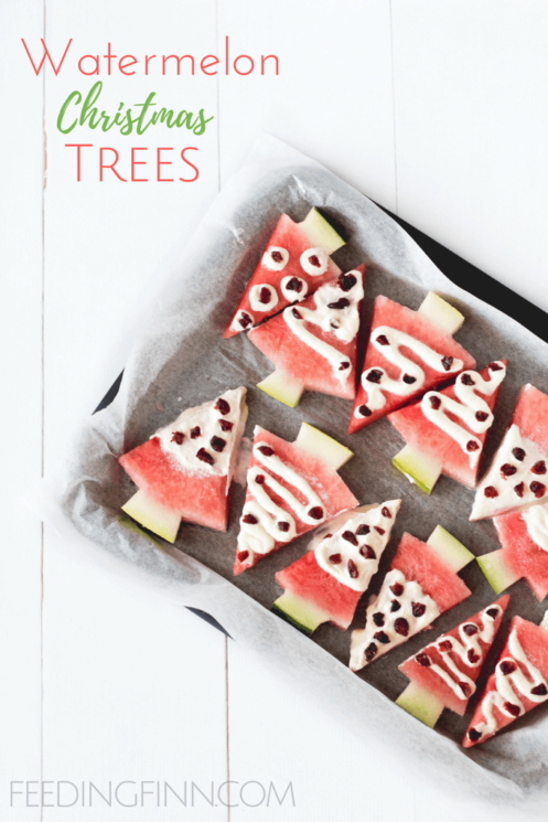 Watermelon cut into wedges to look like Christmas trees with yogurt and mini chocolate chips