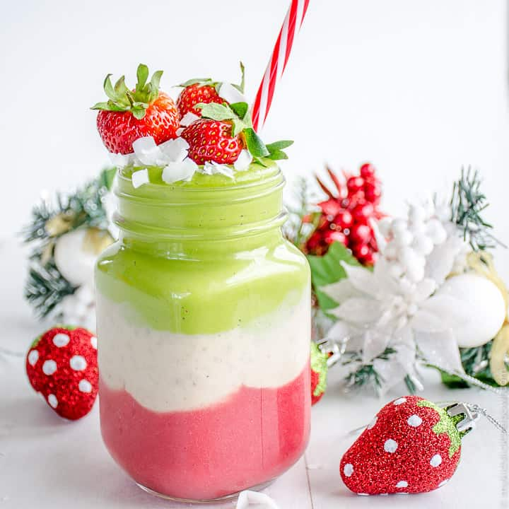 Jar Mug with a green, white and red layered smoothie topped with strawberries and a red and white straw