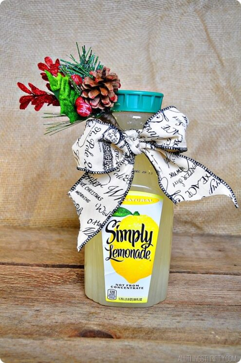 a bottle of lemonade with a bow