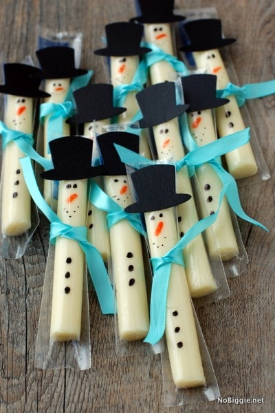 String cheese with snowman decorations made of paper