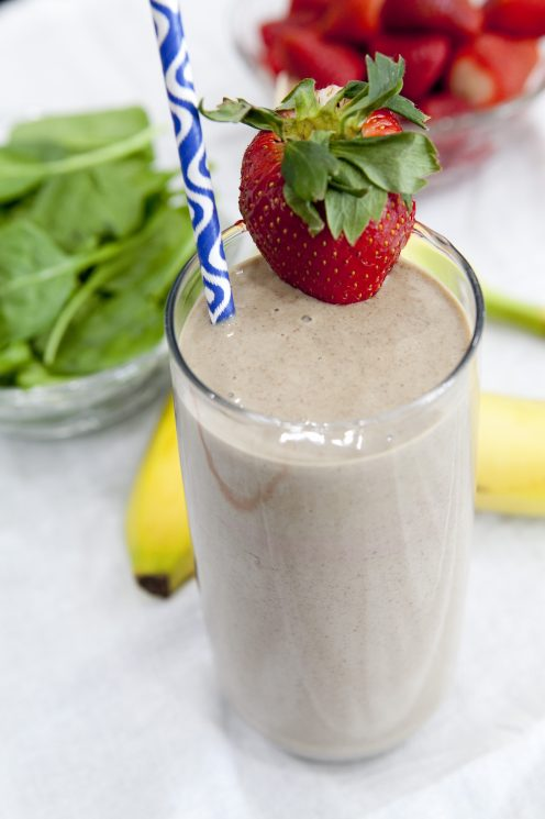 This healthy and satisfying Strawberry Banana Flax Smoothie recipe will keep you going throughout your day with yogurt, fruit, flaxseed, and spinach. www.superhealthykids.com