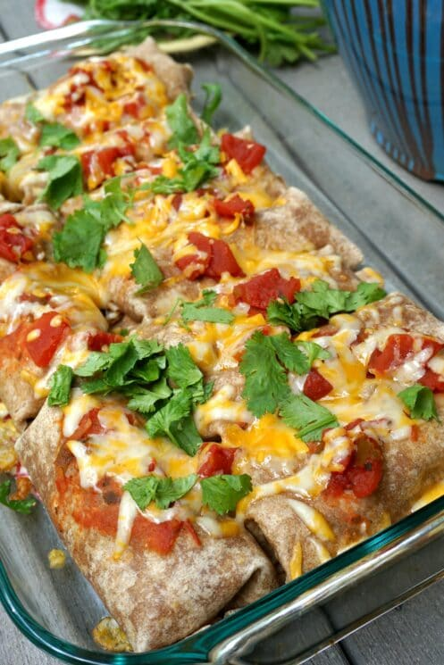 Closer look of baked pan of beef and bean burritos.