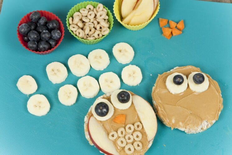 fun food for kids idea- owl rice cakes, preparation, bananas and blueberries and fruit
