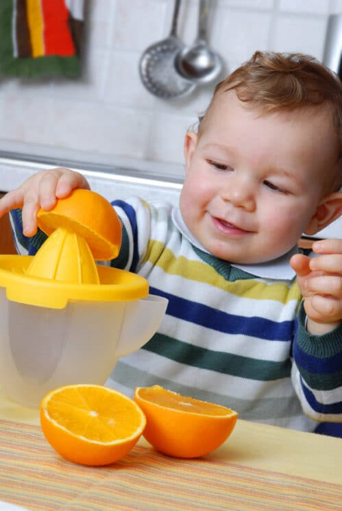 Healthy Snacking for Toddlers, baby juicing oranges