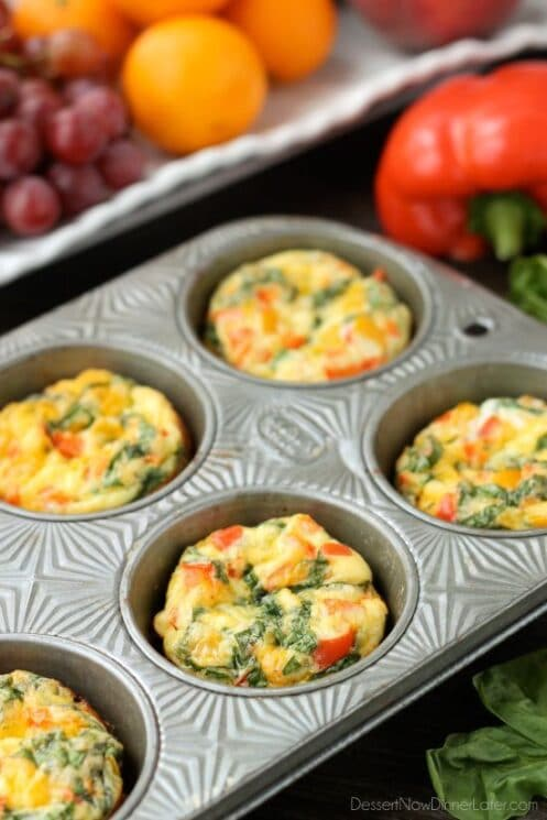 Egg Cups in a Muffin Tin with Fruit in the Background