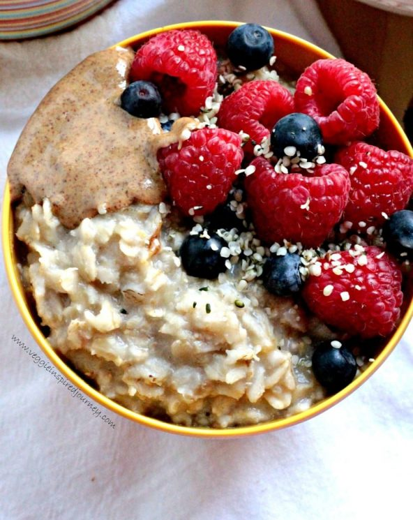 Creamy Healthy Oatmeal with Berries, Almond Butter and Hemp Seeds