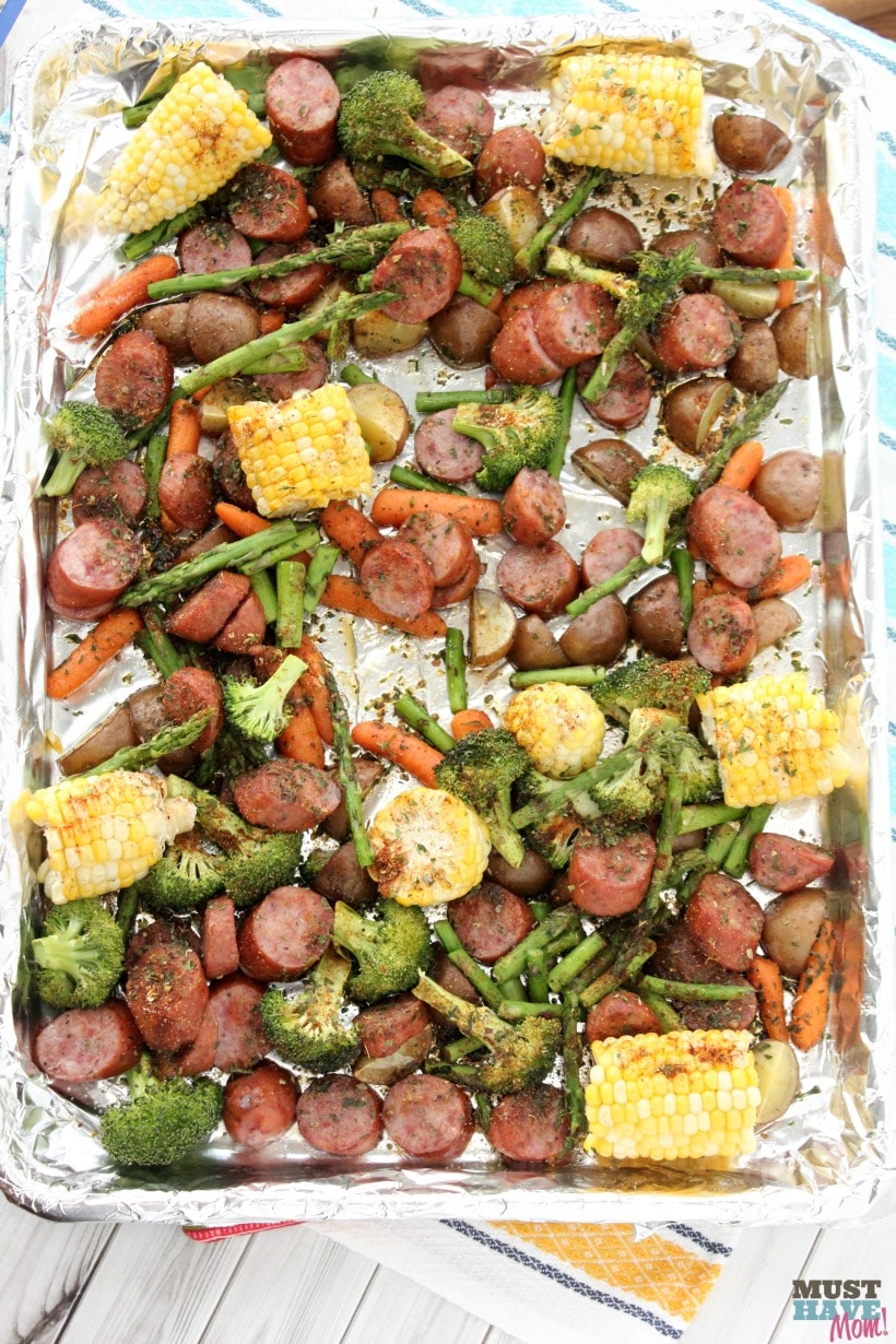 Healthy Easy Sausage and Veggie Sheet Pan Dinner with corn and broccoli and sausage and carrots