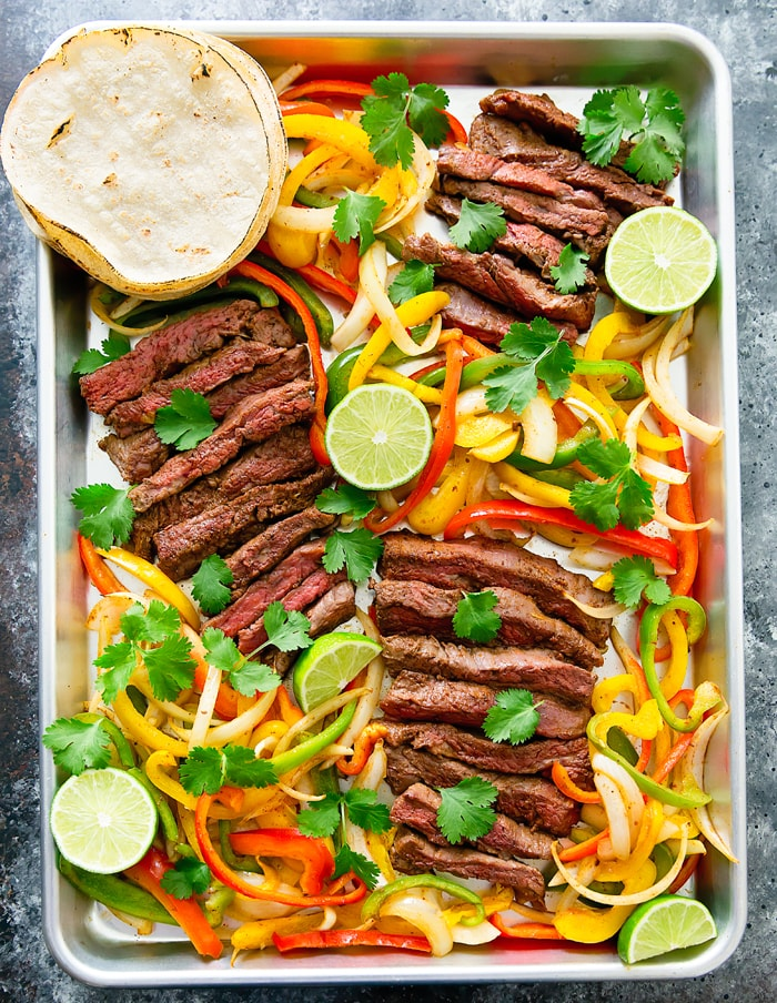 Sheet Pan Steak Fajitas Dinner with peppers and lime and steak
