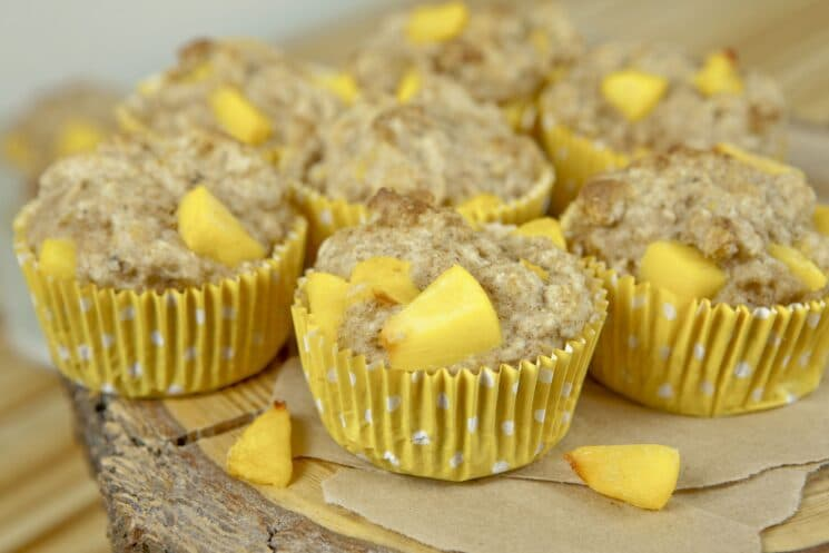 peach muffins in yellow cupcake liner- Healthy muffin recipes