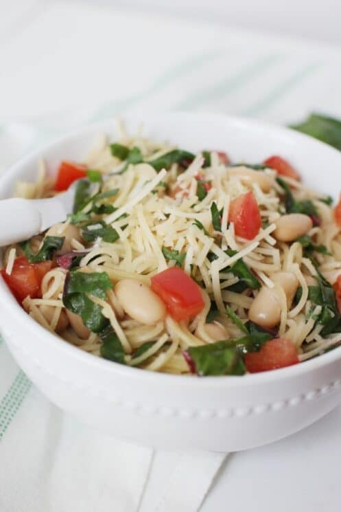 Garlic Pasta with Swiss Chard in a bowl with a fork