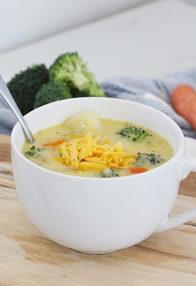 some vegetables in this cheesy soup are carrots, broccoli, potatoes an carrots